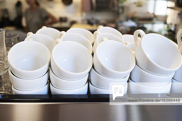 Lots of coffee cups in a cafe