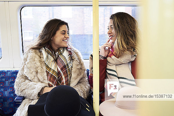 UK  London  two happy women in underground train