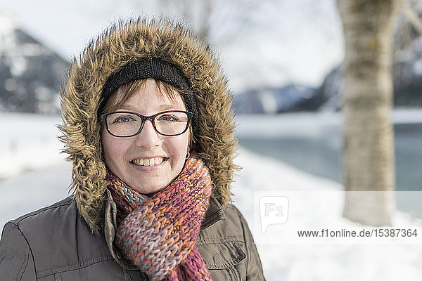 Portrait of smiling woman in winter