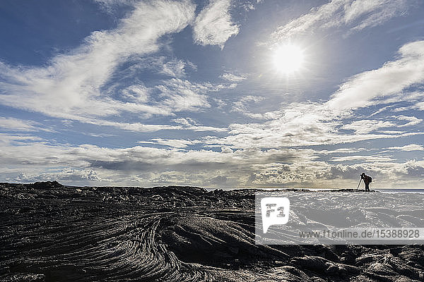 USA  Hawaii  Big Island  Volcanoes National Park  Ka Lae Apuki  photographer on lava field