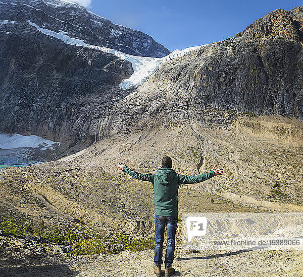 Canada  Jasper National Park  Hiker with raising arms at Mount Edith Cavell and Angel Glacier
