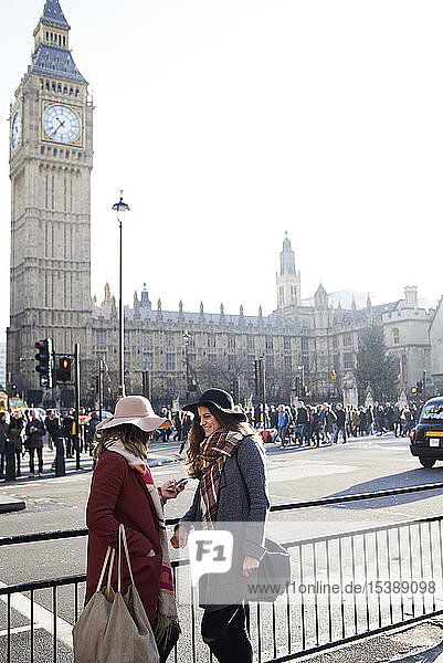 UK  London  two women in the city near Big Ben