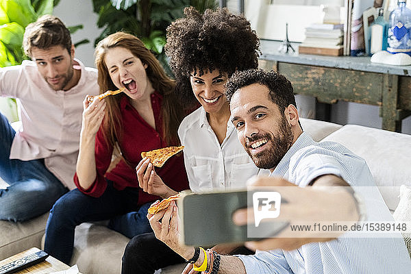 Freinds having fun  eating pizza together  taking selgies