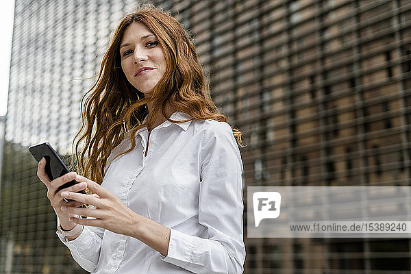Young businesswoman in the city  using smartphone