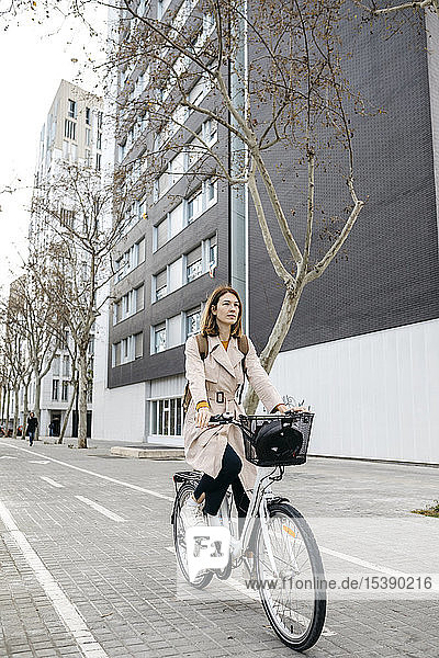 Woman riding e-bike in the city