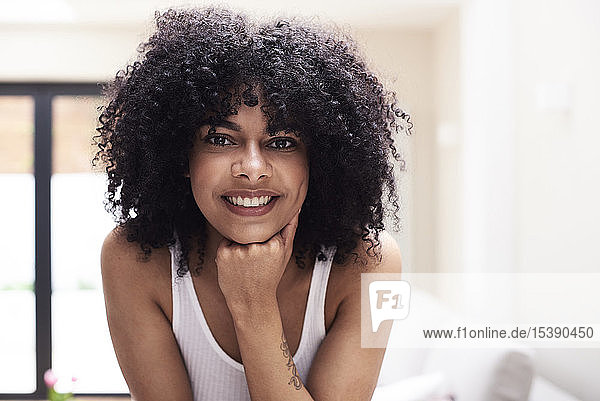 Portrait of smiling beautiful young woman