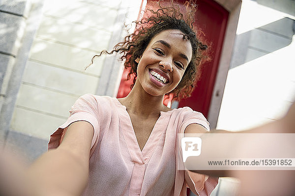 Selfie of a happy young woman in the city