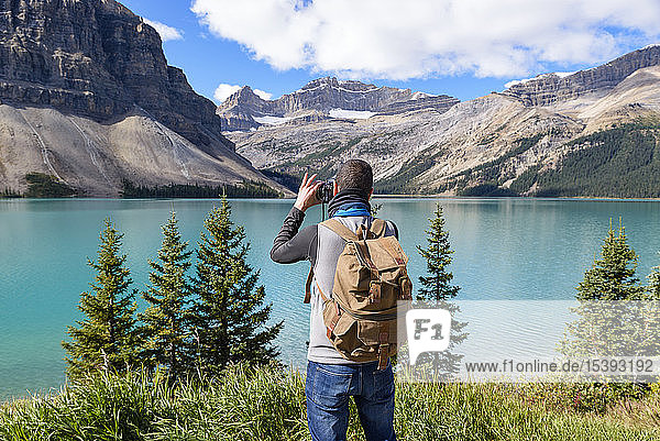 Canada  Jasper and Banff National Park  Icefields Parkway  man at lakeside