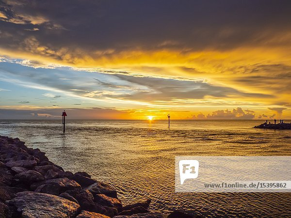 Sunset over the Gulf of Mexico at the Jetty in Venice Florida.