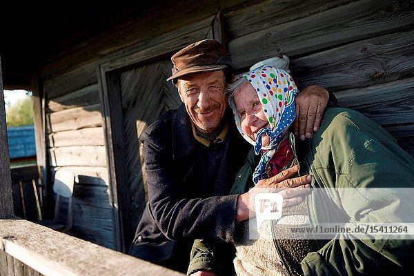An Elderly Couple in front of a Farmstead