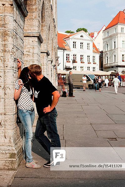 Couple kissing on Town Hall Square in Tallinn