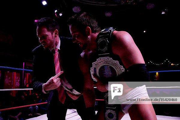 Kiel  Germany - December 08  2018. English Wrestler Kay Jutler is winning the Maximum Championship of Apu Singh