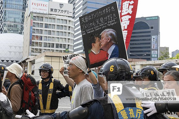 Protesters holding placards against the US President Donald Trump's visit to Japan during a rally in Shinjuku on May 26  2019  Tokyo  Japan. Tokyo Police prevented a clash between a small group of right-wing people and protesters against US President Donald Trump's visit to Japan and the country's new Emperor Naruhito. Trump is currently on an official four-day state visit to Japan. He is the first foreign leader to visit the country after the coronation of Emperor Naruhito.