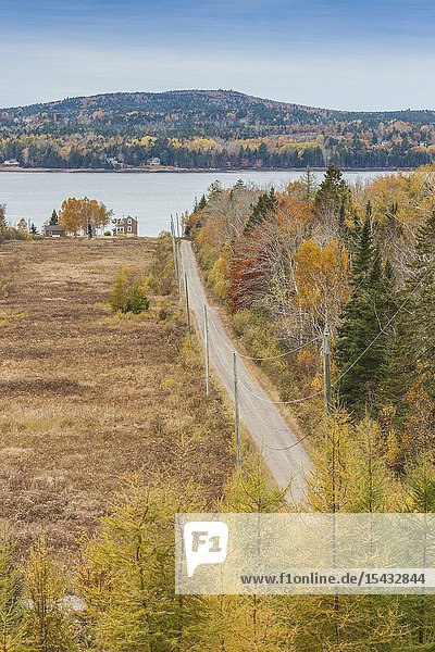 Canada  New Brunswick  Bay of Fundy  Bayside  elevated view of country road and house  autumn.