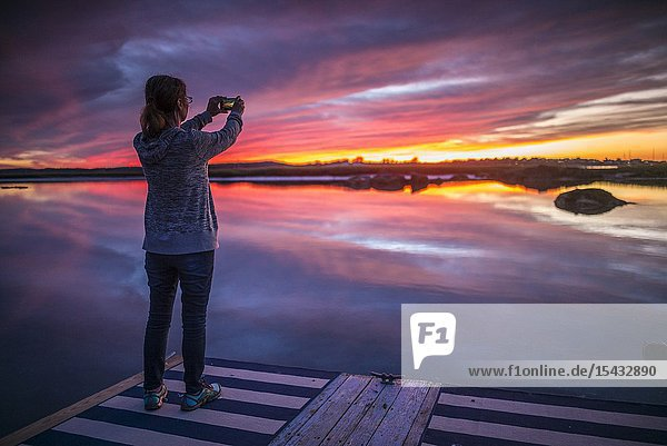 USA  New England  Massachusetts  Cape Ann  Gloucester  Annisquam Harbor  sunset with photographer  MR-MA-18-001.