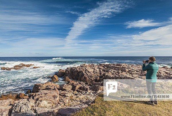 Canada  Nova Scotia  Cabot Trail  Neils Harbour  Cape Breton HIghlands National Park  tourists by the shore  NR.