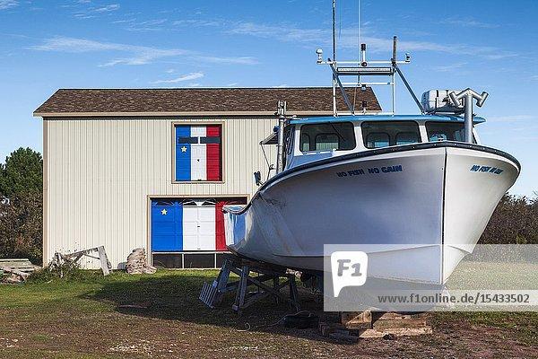 Canada  Prince Edward Island  Maximeville  boat and Acadian painted boathouse.
