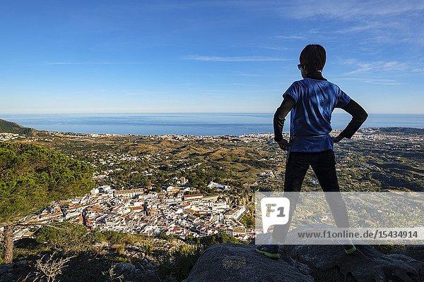 Hiker. Panoramic landscape  white villa of Mijas & Fuengirola. Malaga province Costa del Sol. Andalusia Southern Spain  Europe.