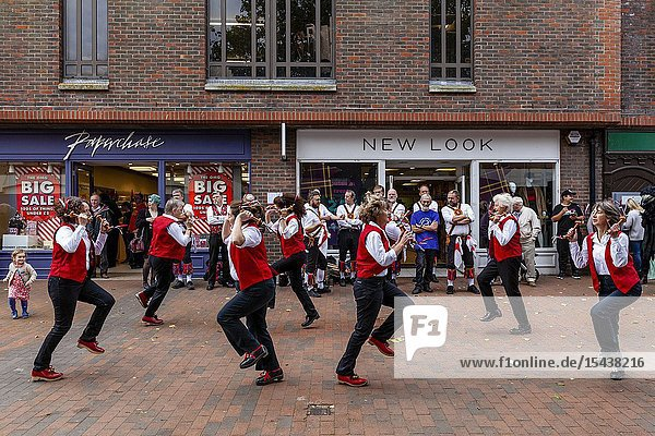 A Group of Female Morris Dancers Perform In The High Street During The Annual Lewes â.Day of Danceâ.  Lewes  Sussex  UK.
