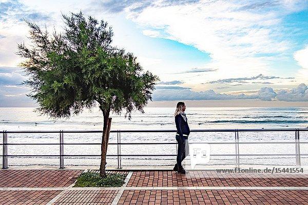 Pregnant woman enjoying the coastline of Gran Canaria.