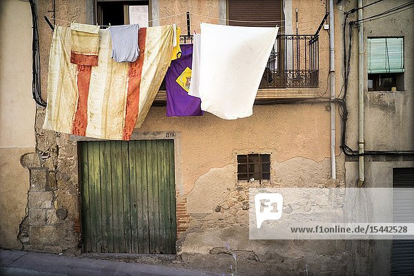 Ypical façade of village house with clothes laid out. Falset  Tarragona  Catalonia  Spain  Europe.