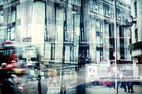 View of a street reflected in a glass with traffic  people and buildings. Selfridges  Oxford St. Londes  UK  Europe.