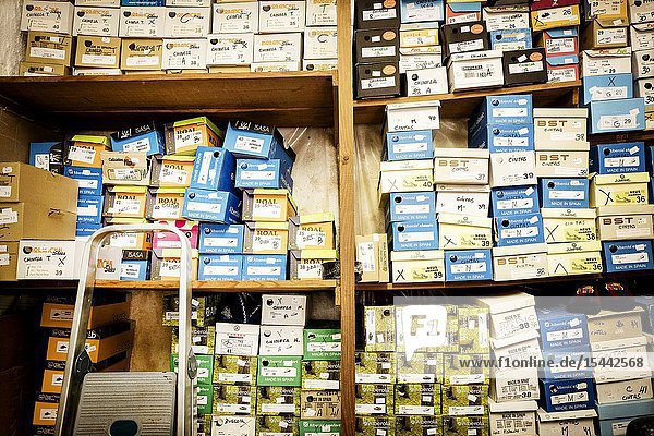 Shelf full of shoe boxes in a shop. Ciutadella  Menorca  Baleares  Spain  Europe.
