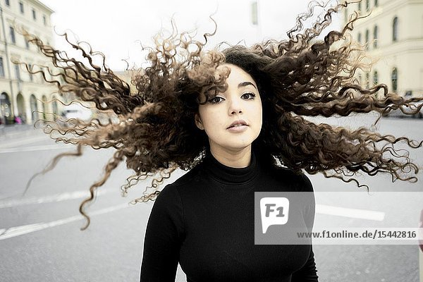 Woman with hairs in wind  in Munich  Germany