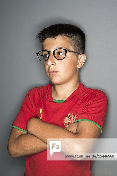 11 years old Portuguese boy in spectacles.