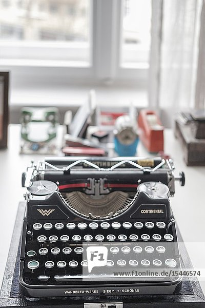 Old German ' Continental' typewriter machine on desktop- selective focus.