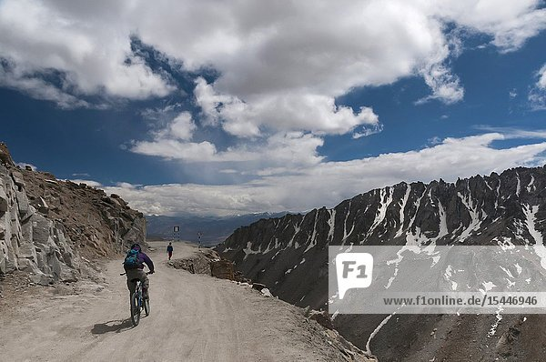 LADAKH  INDIA  August 2012  Cyclist at Khardungla Pass the highest motor road in the world.