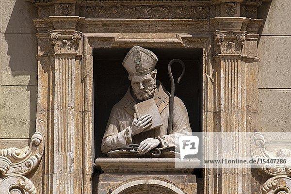Statue above the entrance of the Chapel of Saint Valero  La plaza de la Almoina in Valencia  Spain  Europe.