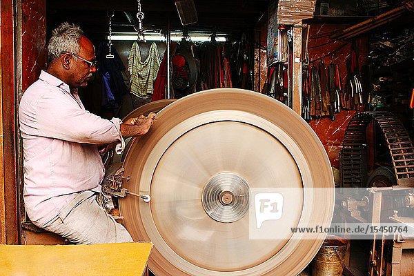 PUNE  MAHARASHTRA  INDIA  January 2019  Person sharpening knifes.