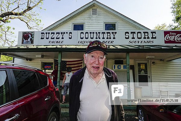 Point Lookout  Maryland USA A senior man stands in front of a local country store.