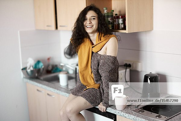 Young smiling woman in kitchen