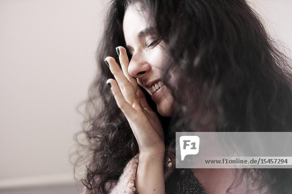 Young woman rubbing her eyes at home