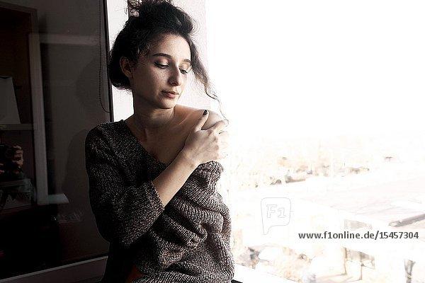 Young sensual woman feeling emotions