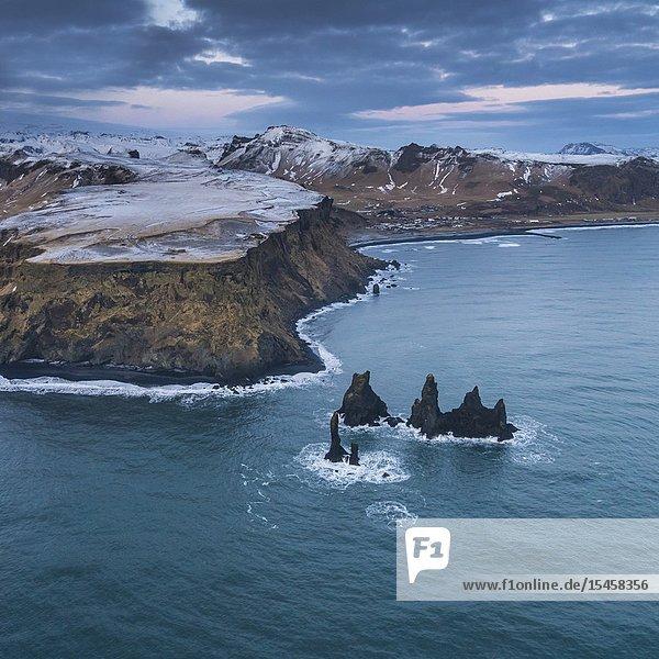 Sea Stacks  Reynisfjara beach  Mt. Reynisfjall  South Coast  Iceland.