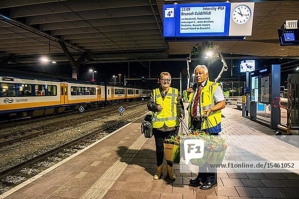 Rotterdam  Netherlands. Last ride of the International Benelux Train between Rotterdam Central Station and Brussels  Belgium on April 8  2018. This Intercity Train Line was established during the 1950's  so an era comes to an end. Railroad employees waiting with a bouquet of flowers for train employees and passengers.