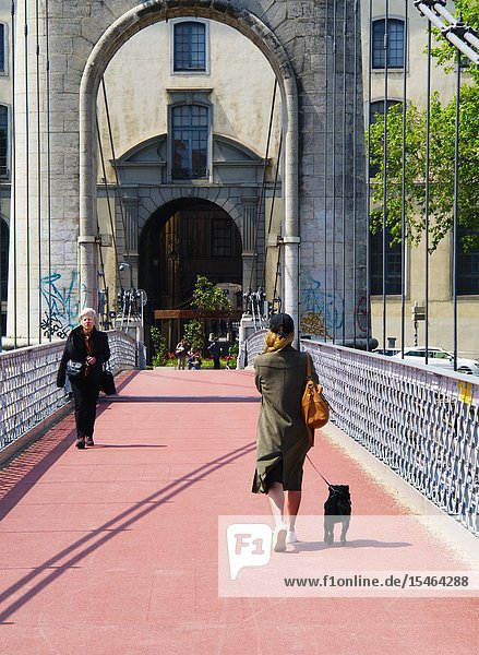 Woman with a small dog on Passerelle du College  Lyon  France.