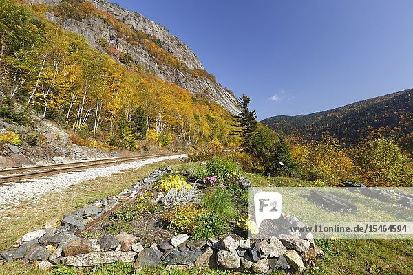 The site of the Mt. Willard Section House along the old Maine Central Railroad  next to the Willey Brook Trestle  in Crawford Notch in New Hampshire. This section house was built in the late 1800s to house the section foreman  his family  and crew who maintained Section 139 of the railroad. From 1903-1942  the Hattie Evans family lived in the house. It was razed in 1972.