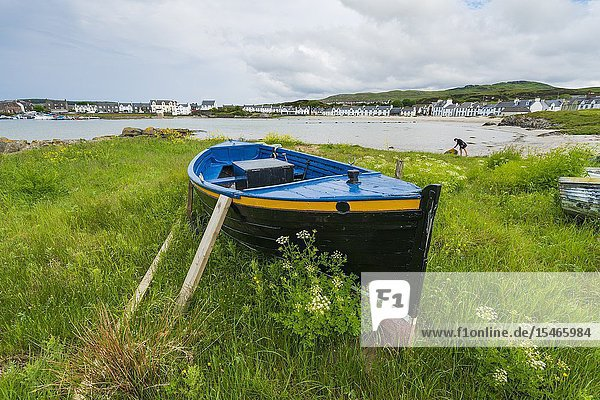 View of boat on shore at Port Ellen on Islay in Inner Hebrides   Scotland  UK.