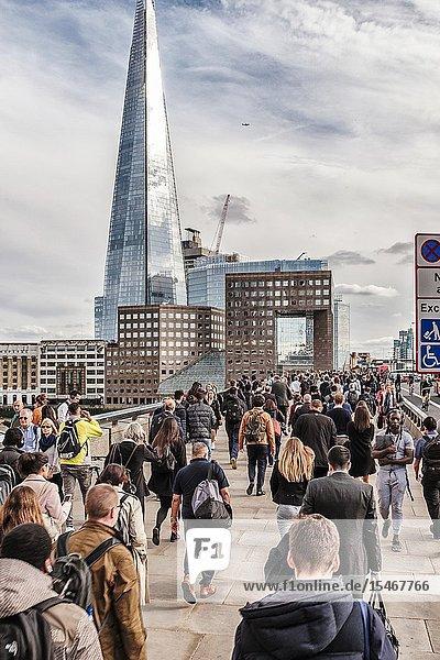 Commuters rush on London Bridge  London UK.
