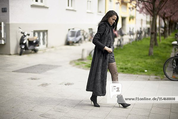 Woman walking at pavement  in Munich  Germany.