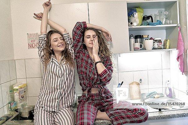 Young women wearing pyjama in kitchen