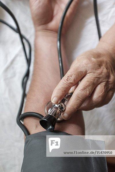 POV-Doctor checks patients blood pressure  selective focus.