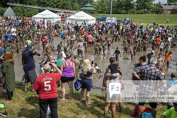 Westland  Michigan - Children age 12 and younger  along with some parents  play in the mud during the annual 'Youth Mud Day' organized by Wayne County Parks.