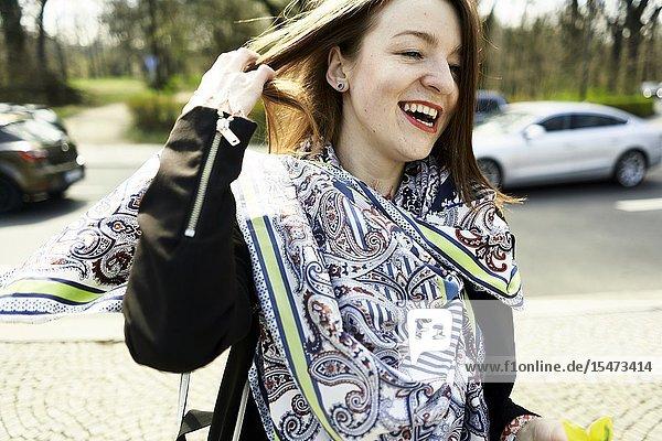 Happy woman at street