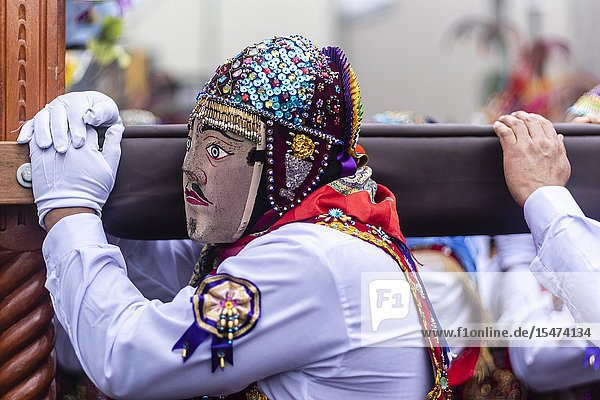 Procession of the Virgen del Carmen of Paucartambo (Cusco)  characters and typical costumes. Peru South America.