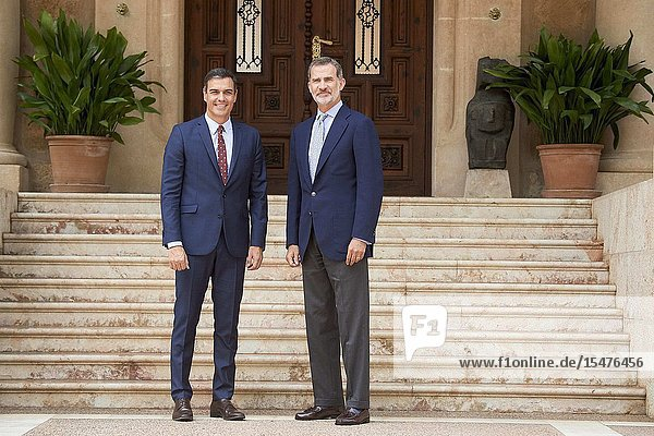 King Felipe VI of Spain  Pedro Sanchez  Prime Minister pose for photographers before a meeting at Marivent Palace on August 7  2019 in Palma  Spain